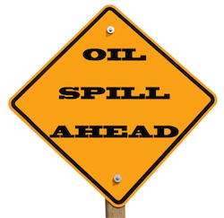 © Digitalreflections | Dreamstime.com - Oil Spill Ahead Sign Photo