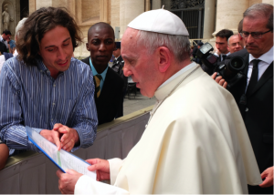Pope Francis is informed about the Catholic Climate Petition by GCCM representatives (Tomás Insua from Argentina and Allen Ottaro from Kenya). Credit: Fotografia Felici