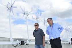 Intel CEO Brian Krzanich on the roof of Intel's headquarters Robert Noyce Building checking out the company's new wind microturbines. Intel is installing a total of 58 microturbines as part of a pilot wind power project. With Krzanich is Josh Beckwith, construction project manager with JLM Energy, the Rocklin California company that built and is installing the microturbines.