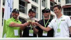 From left, Pat O'Keefe, Michael von Disterlo and Luke Lonberger of CLP Motorsports join X Games Gold Medal Winner Tanner Foust in toasting the successful conclusion of the 2,507-mile cross-country drive on one tank of Neste NEXBTL renewable diesel in Santa Monica, CA. (PRNewsFoto/Neste)