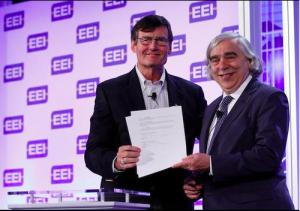 EEI President Tom Kuhn and Energy Secretary Moniz sign an MOU on electric vehicle adoption. — in New Orleans, Louisiana. Photo Credit: EEI