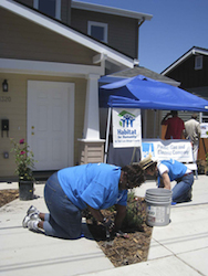 PG&E employee volunteers help to put in landscaping on a Habitat home equipped with solar panels in San Luis Obispo, Calif.