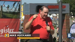 Former Arkansas Governor Mike Huckabee addresses the crowds on the Presidential Soapbox during the Iowa State Fair.