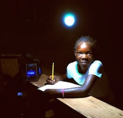 Child-using-an-energy-kiosk-in-Kenya-300