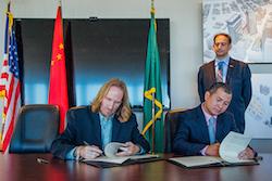 Paul-Woods-and-Wang-Suwei-Sign-Partnership
