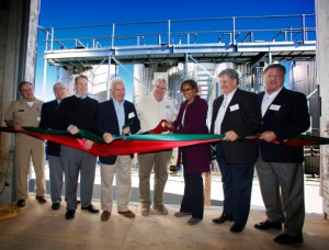(From Right to Left) JJ Rothgery, Chairman of the Board at Biodico; Russ Teall, President and Founder of Biodico; Janea Scott, California Energy Commissioner; John Diener, President and CEO, Red Rock Ranch; Jim Costa, U.S. Congressman; Jim Houston, Undersecretary of the California Department of Food and Agriculture; Dr. Frank Gornick, Chancellor of the West Hills Community College District; and Captain Monty Ashliman, Commanding Officer, Naval Air Station Lemoore, at Biodico Westside Facility Ribbon Cutting Ceremony at Red Rock Ranch in Five Points, Calif. (Photo: Business Wire)