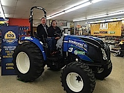 Bill and Katherine Howell take a seat in their new New Holland Boomer 47 as part of the 2015 Growth Energy Individual Member Sweepstakes. Photo Credit: Carroll Broadcasting Company.
