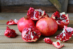 © Olhaafanasieva | Dreamstime.com - Ripe Pomegranates On A Rustic Table