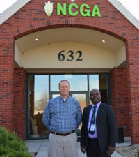 NCGA's Paul Bertels and Nigerian Corn Growers Association's Edwin Uche in front of the NCGA office.