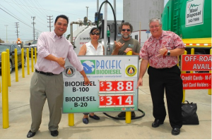 Maui County Council Vice Chair Don Guzman, who proposed the tax exemption, shows his support for the biodiesel price rollback with Kelly and Bob King, Pacific Biodiesel founders, and Councilmember Don Couch. Photo: Pacific Biodiesel Technologies