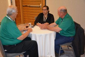From left to right: Dale Christensen, Glacial Lakes Energy; Joanna Schroeder, Energy.Agwired.com; and Mark Schmidt, Glacial Lakes Energy, discuss the Premium E30 Challenge during the 29th Ethanol Conference.