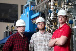 Lysle Whitmer, Ryan Smith and Martin Haverly, left to right, led the development of a pilot plant as part of a joint biofuels project with Chevron U.S.A. Larger photo. Photos by Christopher Gannon.