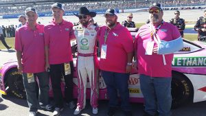 American Ethanol Sweepstakes winners received the ultimate experience during the NASCAR race at Talledega. Pictured here are the winners with driver Austin Dillion.