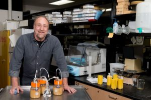 UW-Madison food science Professor James Steele with homemade fermenters he's using to explore genetic engineering of lactic acid bacteria, a common contaminant of many fermentation processes, including cheese, wine, beer and biofuel production. PHOTO: SEVIE KENYON - See more at: http://news.wisc.edu/food-scientist-aiding-fuel-ethanol-with-new-engineered-bacteria/#sthash.cZfk0sBM.dpuf